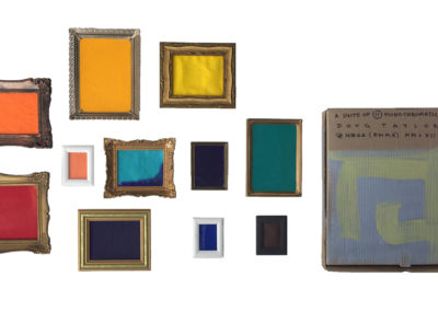 A Suite of 11 Monochromatic Paintings (Doug Taylor), 2012: Paintings, cardboard box, metal frames, plastic frames. Collection of Arthur Perlett and Veronica Tricker.