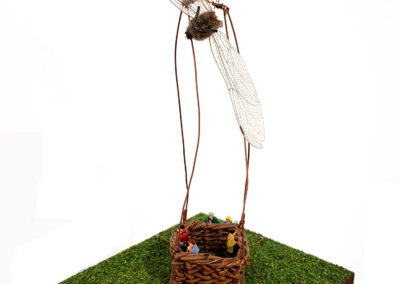 Taking Flight (Rebecca Asquith, Eva Seidenfaden), 2016: Willow, walnut, dragonfly, copper, minature figures, minature grass. Collection of Bev and Craig.