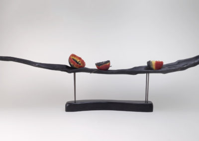 3. Under Currents (Louisa Ferguson), 2018: Pâte de verre, wood, steel. $550