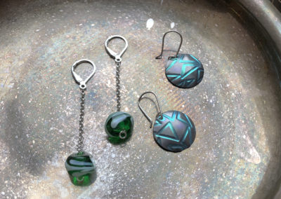 Earrings by (left to right) Jolene Dusyk & Deborah Potter.