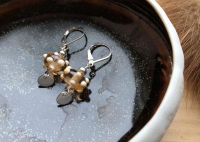 Earrings by Jolene Dusyk & dish by Jack Sures.