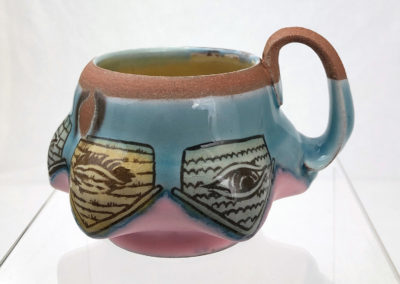 20. Neighbourhood Watch Mug (Shaun Mallonga, Ontario), 2018: Red stoneware, slip, glaze; wheel thrown, altered, sgraffito, glaze trailing. 8 x 13 x 11. $65