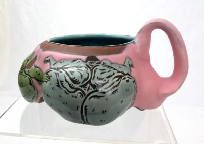 23. Badass Betties Mug (Shaun Mallonga, Ontario), 2018: Red stoneware, slip, glaze; wheel thrown, altered, sgraffito, glaze trailing. 7 x 16 x 15. $80
