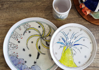 28. Solastalgia: The sea (Marney McDiarmid, Ontario), 2019: Cone 6 porcelain, underglazes; handbuilt. Large plate: 27 x 27 x 1; Small plate: 21 x 21 x 1; Tumbler: 10.5 x 7 x 7.5. $215