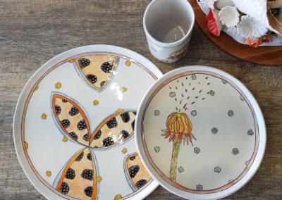 29. Solastalgia: Seeds (Marney McDiarmid, Ontario), 2019: Cone 6 porcelain, underglazes; handbuilt. Large plate: 27 x 27 x 1; Small plate: 20 x 20 x 1; Tumbler: 10.5 x 7 x 7.5. $215