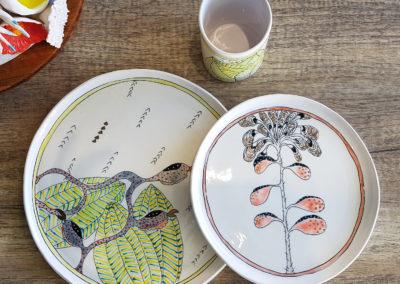 31. Solastalgia: The Amazon (Marney McDiarmid, Ontario), 2019: Cone 6 porcelain, underglazes; handbuilt. Large plate: 27 x 27 x 1; Small plate: 21 x 21 x 1; Tumbler: 10.5 x 7 x 7.5. $215