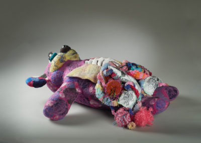 16. Anatomy of an Anxiety Hug Keeper (Laura Kinzel), 2019: Wool roving, spun wool, assorted yarns, glass beads, cotton and polyester thread, polyester stuffing, cotton fabric, polymer clay, plaster bandages, wire, acrylic paint, acrylic gel, fibre paint, human eyelashes; beaded, embroidered, needle felted, sewn, clay modelled, sculptural armature construction.  29 x 80 x 82. $2000 NFS. Corinne McKay Merit Award for SCC Members.