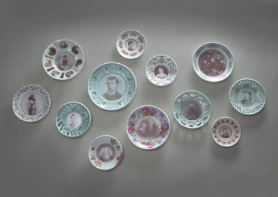 20. Forgotten (John Peet), 2018: Porcelain, photo and vintage decals; thrown, carved, high fired. 88 x 151.5 x 6.5. $1200. Dimensions 2019 Award for the Outstanding Entry.