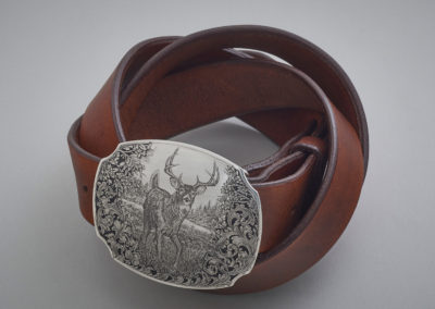 29. Watchful (Robert Spark), 2019: Sterling silver buckle and leather belt with steel Chicago screws with silver caps; hand-engraved in bulino and Western single point styles. 8.5 x 15 x 17.5. $4500. Award for Excellence in Metal.