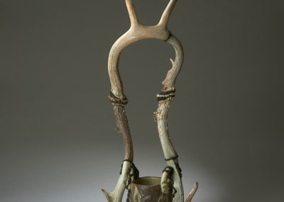 33. Antler Vase #2 (Jeffrey Taylor), 2018: Clay, antler, copper, solder, epoxy, steel rod; wheel thrown, altered, carving, metalwork. 77 x 33 x 23. $1250