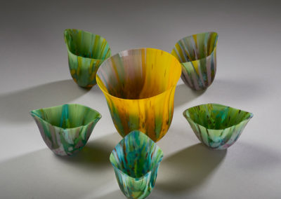6. First Bloom (Kimberley Dickinson), 2019: Sheet glass, frit, stringers, drop molds; glass fused, drop molded, coldworked, sandblasted, waxed. Large vessel 11.5 x 11 x 11; 5 five small vessels approximately 8.5 x 10 x 6.5 each. $1000