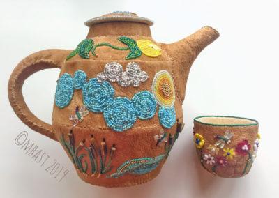 beaded leather teapot
