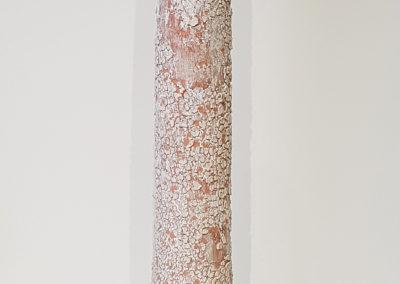 63. Single Tube 3 (Darren Emenau), 2018: White earthenware, MNO lichen glazes; multi-fired in low fired oxidation kiln. 56 x 13 x 13 cm. $380
