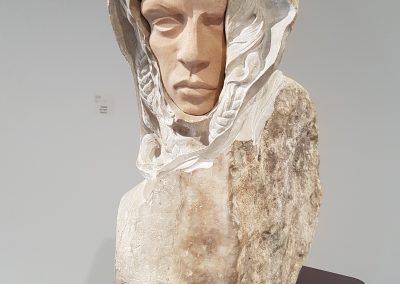 Dreamwalker (Robert Assié), 2019: Field marble; hand carved. Stand: 104 x 56 x 37 cm, Sculpture: 72 x 22 x 52 cm. $9800