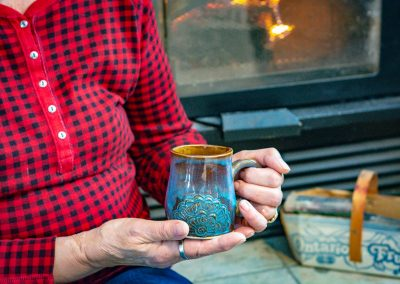 Mandala mug by the fire