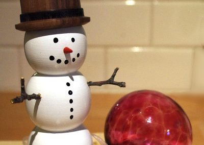 Snowman by Dale Lowe, glass ornament by Jacqueline Berting